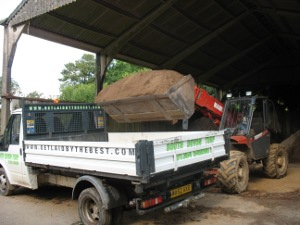 Loading dry screened soil
